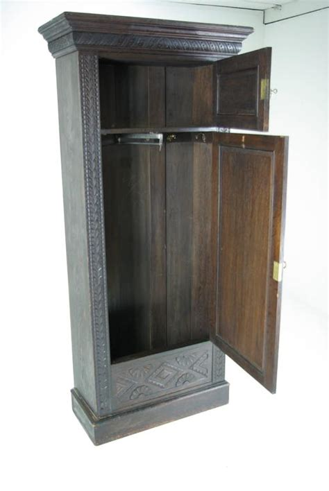 Single Door Wardrobe Closet by B391 Heavily Carved Oak Single Door Armoire