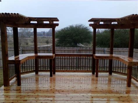 beautiful custom built deck with rod iron rails and arbor