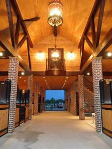 15 amazing horse barns you could probably live in With barn stall lights