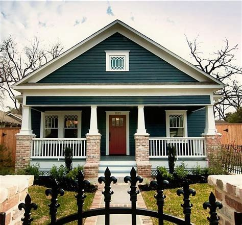 ornate black fences and navy blue exterior paint colors