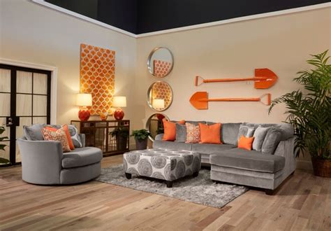 orange living room furniture the application of orange and cool grey in this living room set compliments the contemporary