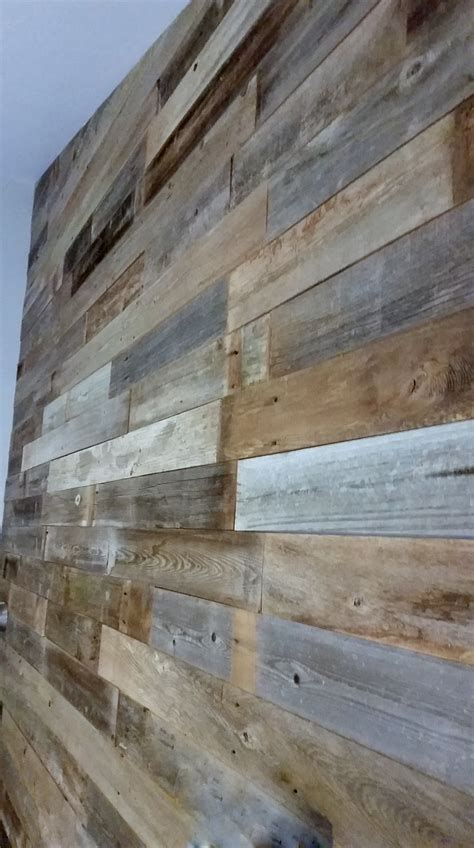 reclaimed wind fence wall planks sustainable lumber company
