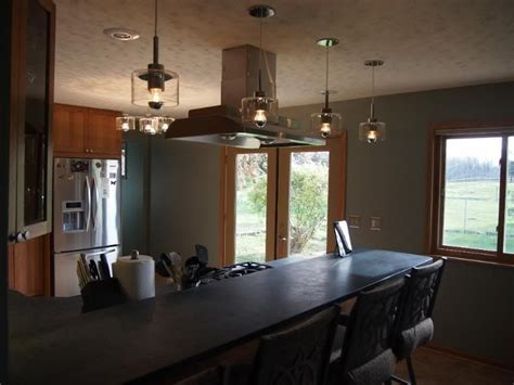 Image result for pendant lighting above island with range