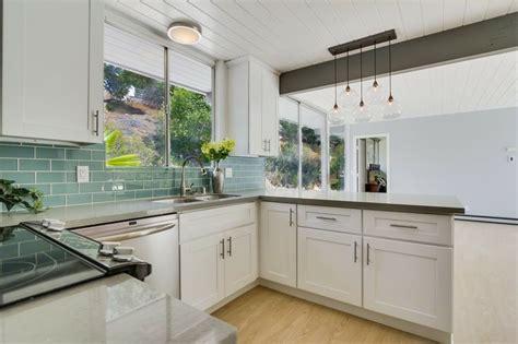 Midcentury Modern Kitchen With White Cabinets, Quartz