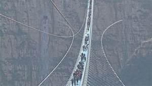 World's longest glass-bottom bridge opens in north China ...