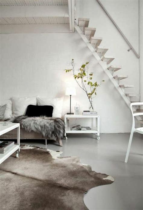 skandinavisch einrichten wohnzimmer kuhfell teppich im wohn oder schlafzimmer verlegen