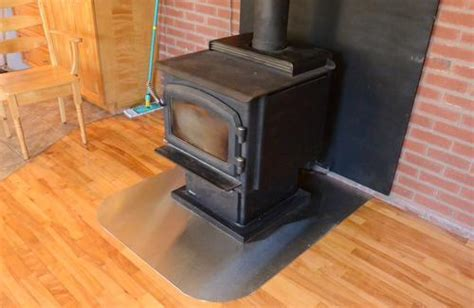 Wood stove hearth plate from stainless steel