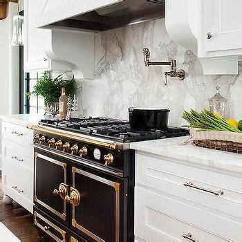 white kitchen  black french stove transitional kitchen