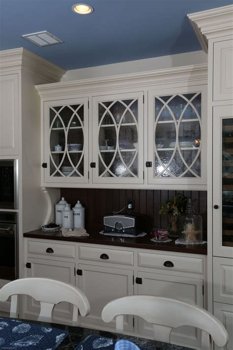 mullions for kitchen cabinets white painted hutch cabinetry with curved mullions and