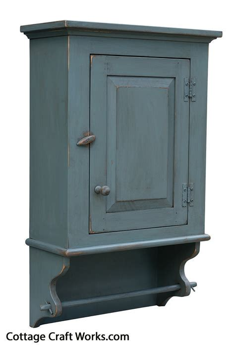 Primitive distressed country wall cupboard, towel rod