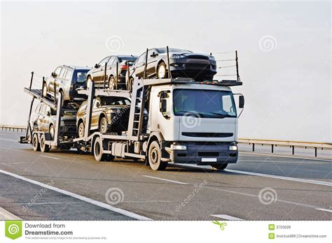 car carrier truck deliver new auto batch to dealer stock