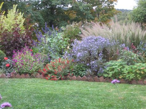 border grasses for landscaping beautiful mixed border with brick edging aster liitle carlow and the ornamental grass