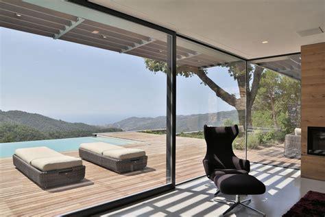 modern italian stone villa   hill overlooking  ligurian landscape   sea
