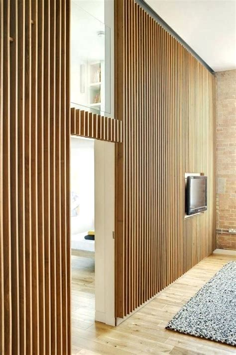 Wood slats for walls, in the fact that have had a wood. Vertical wood panel wall | Wood slat wall, Timber walls, Interior