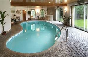 Modern indoor swimming pools design ideas home interior for Indoor swimming pool designs for homes