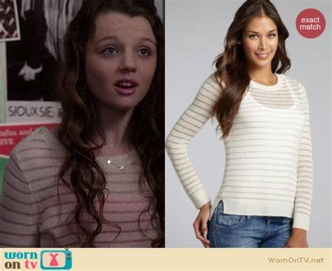 Dorrit's sheer white striped sweater with shoulder buttons ...
