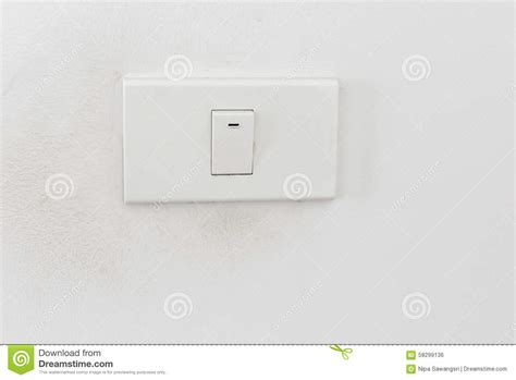 light switch white light switch on white wall stock