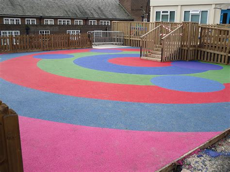 Poured Rubber Flooring For Playgrounds by Playground Flooring