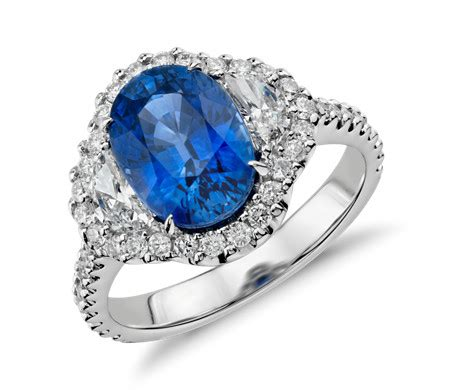 Blue Sapphire And Diamond Halo Threestone Ring In 18k. Significance Engagement Rings. Gold 2016 Engagement Rings. Seven Stone Engagement Rings. Celtic Women's Wedding Rings. Gray Wedding Wedding Rings. Barbed Wire Rings. Upside Down Engagement Rings. Sweetheart Engagement Rings