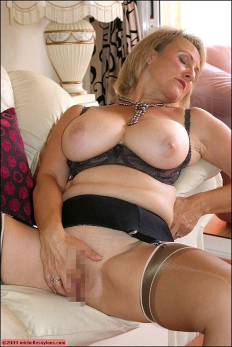 Fat Blond Mature Denudes Her Huge Breasts And Fondles A
