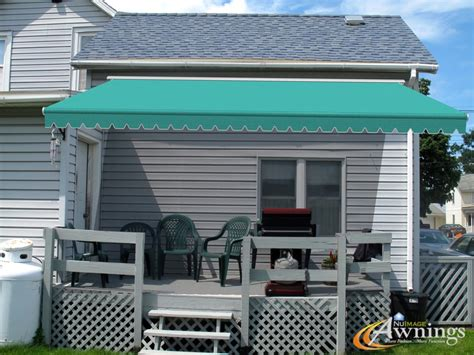 nuimage retractable awning with sunbrella aruba 4612 0000