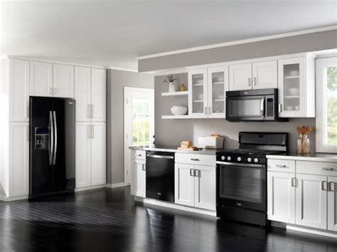 light gray kitchen walls black appliances white light grey cabinets and darker 6987