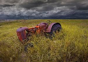 Abandoned Farm Tractor On The Prairie Photograph by