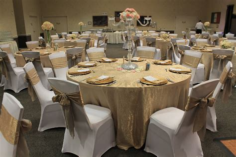 chagne crushed iridescent satin tablecloths and sashes gold charger plates and white