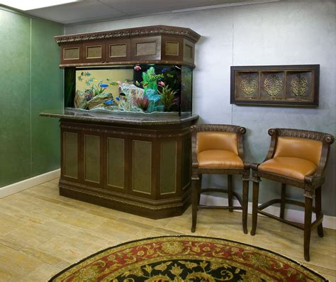this custom crafted freshwater aquarium features nicely