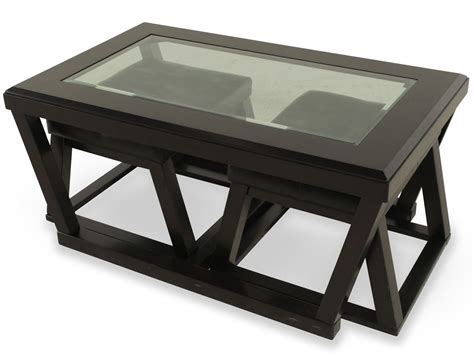 It offers four grab ottomans in cubic forms. Coffee Table With Pull Out Ottomans   Roy Home Design