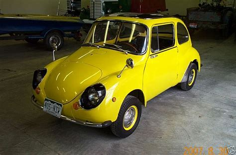 Yellow Subaru 360 Deluxe Sedan