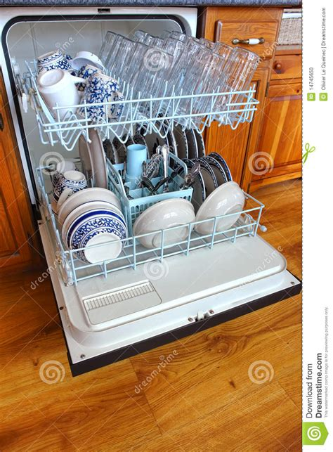 house kitchen dishwasher full  clean dishes stock photo