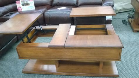 Rolanstar coffee table, lift top coffee table with storage shelves and hidden compartment, retro central table with wooden lift tabletop and metal frame, for living room, rustic brown. Interesting double lift coffee table, doesn't sit flush but neat idea from Ashley - Yelp