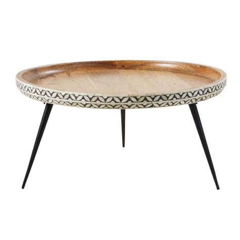 This round coffee table adds the perfectthis round coffee table adds the perfect amount of modern minimalist design to any space. Round Black Metal and Carved Solid Mango Wood Coffee Table Krishna   Maisons du Monde