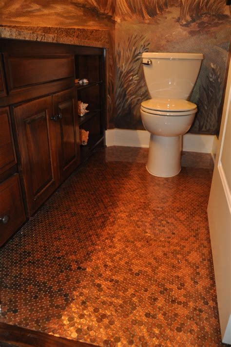 tile your floor with pennies i m seriously considering putting a penny floor down in our guest bathroom bathroom makeover