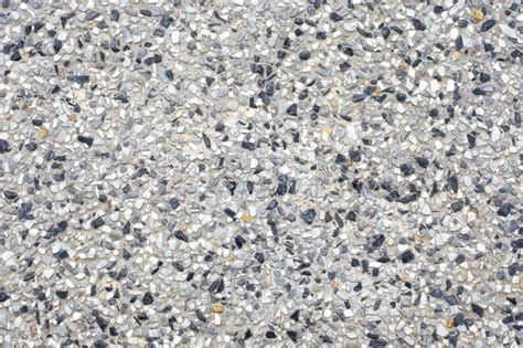 Exposed aggregate concrete texture background   Stock