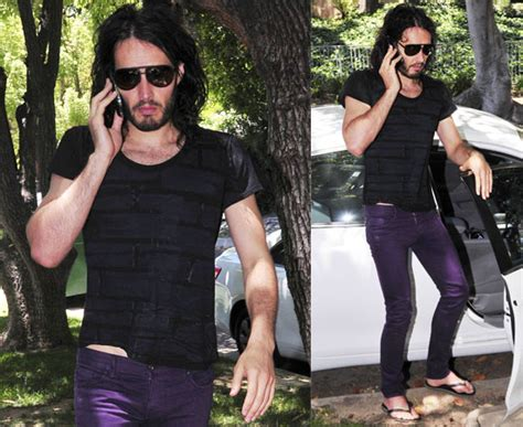 russell brand jeans photos of russell brand in purple jeans in la popsugar