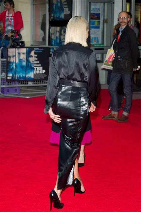 noomi rapace black satin blouse leather skirt satin