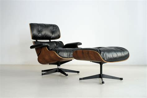 vintage swivel chair and ottoman by charles eames