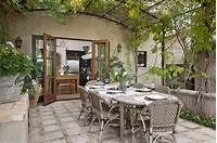 best french country outdoor kitchen Eclectic Patio with Outdoor kitchen, French Bistro Arm Chair, exterior stone floors, French ...