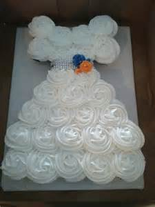 cupcake wedding dress cupcake cake in the shape of a wedding dress for a bridal shower bling for a belt and roses in