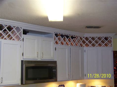 Wine Cupboards by Use The Space Above The Kitchen Cabinets To Create A Wine