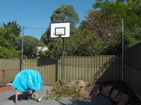 net  fence  stop basketball   backyard