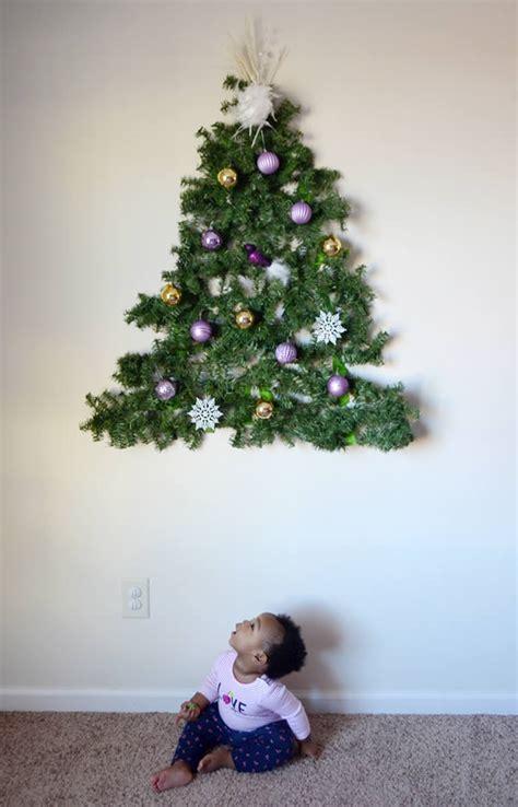 hilarious child  pet proof christmas trees oddee