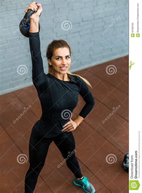 kettlebell exercising weight woman preview
