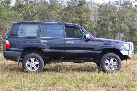 The toyota landcruiser 70 ute stands out with its rugged design and power. Toyota-Landcruiser-100-Series-Wagon-Black-59333-1 ...