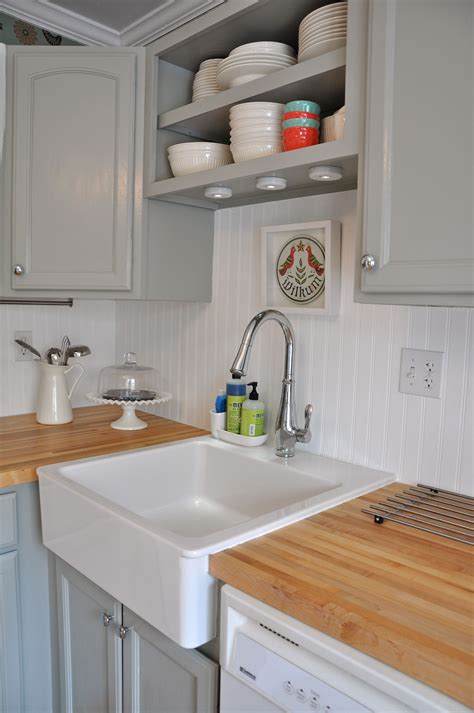 white beadboard backsplash   light grey cabinets
