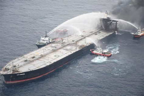 Salvage team working to stop fuel leak from fire-hit ...
