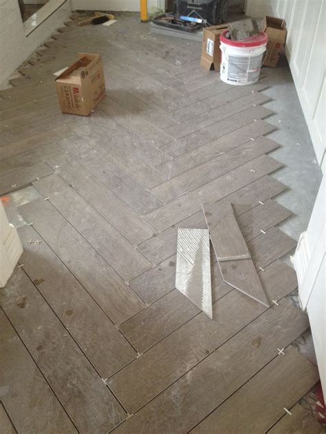 herringbone pattern faux wood tile floors