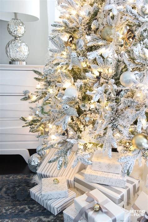 white tree with gold decorations flocked tree white and gold glam style